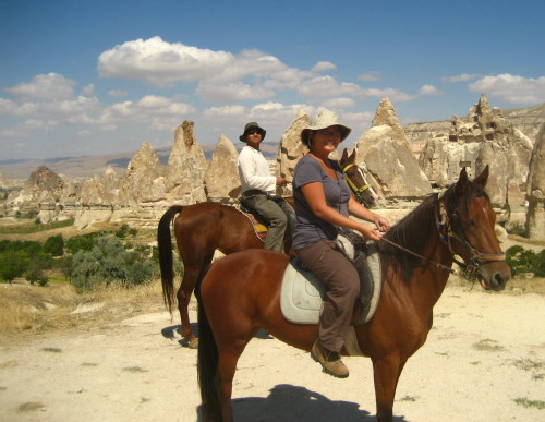 Wabs riding horses around the moonscape of Cappadocia